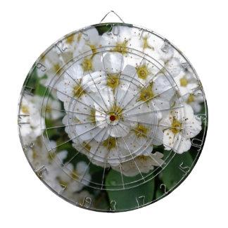 White flowers glowing dart boards