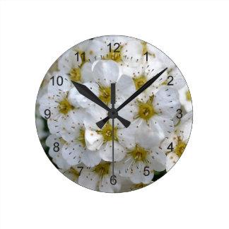 White flowers glowing round clock