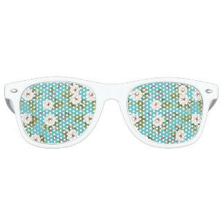White flowers painting on turquoise background retro sunglasses