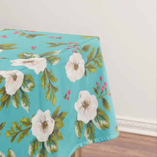 White flowers painting on turquoise background tablecloth