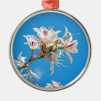 White flowers with pink over blue background metal ornament
