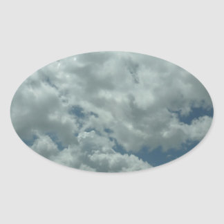 White, fluffy clouds in blue sky oval sticker