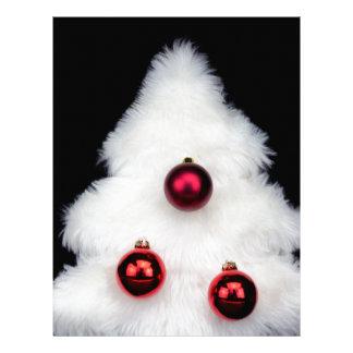 White fur christmas tree isolated on black letterhead