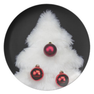 White fur christmas tree isolated on black plate