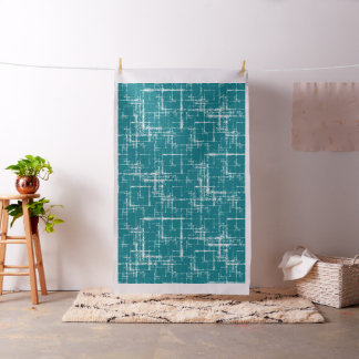 white geometric abstract squares on teal fabric