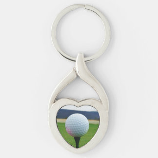 white Golf Ball on a mountain golf course Silver-Colored Twisted Heart Keychain