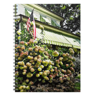 White Hydrangeas By Green Striped Awning Spiral Notebook