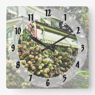 White Hydrangeas By Green Striped Awning Square Wall Clock