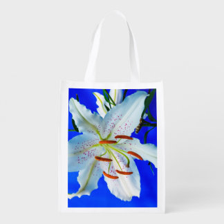 White Lily on Blue Background Reusable Bag Grocery Bags