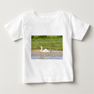White mother swan swimming in line with cygnets baby T-Shirt