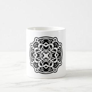 white mug with celtic design