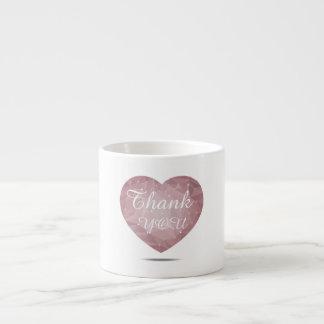 White mug with heart-shaped geometric