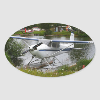 White, navy & grey float plane, Alaska Oval Sticker