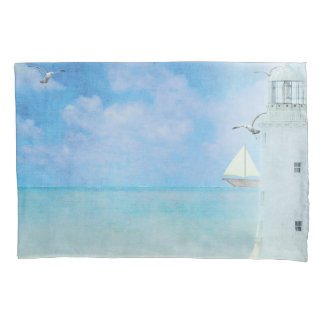 white ocean lighthouse and sailboat pillowcase