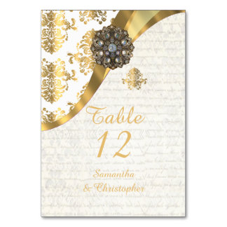 White parchment and gold vintage damask wedding table cards