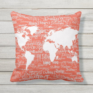 white pattern of names & world map, on coral throw pillow