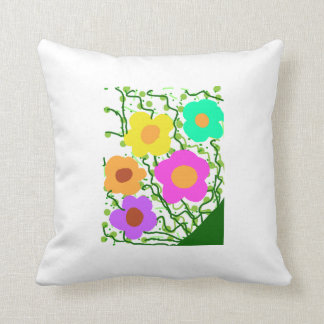 white pillow with flowers