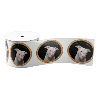White pitbull with red kisses all over his face. grosgrain ribbon