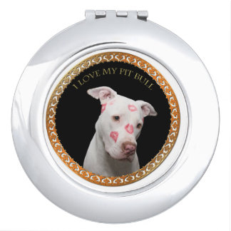 White pitbull with red kisses all over his face. makeup mirror