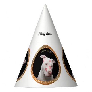 White pitbull with red kisses all over his face. party hat