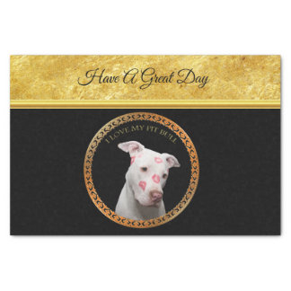 White pitbull with red kisses all over his face. tissue paper