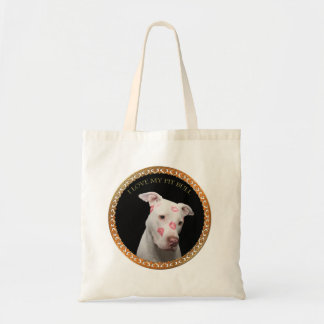White pitbull with red kisses all over his face. tote bag