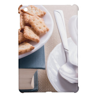 White plate with cookies on old book cover for the iPad mini
