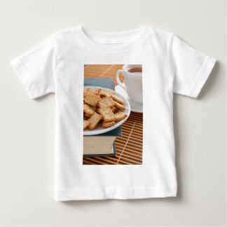 White plate with cookies on the old book baby T-Shirt
