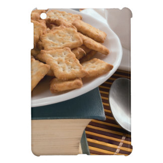 White plate with cookies on the old book case for the iPad mini
