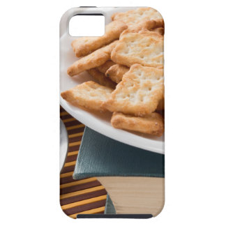 White plate with cookies on the old book case for the iPhone 5
