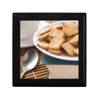 White plate with cookies on the old book gift box