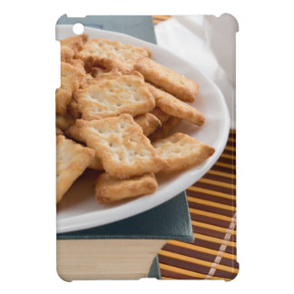 White plate with cookies on the old book iPad mini case