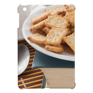 White plate with cookies on the old book iPad mini cover