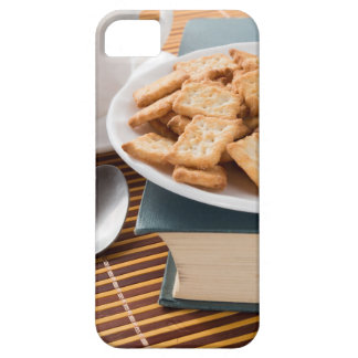 White plate with cookies on the old book iPhone 5 cover