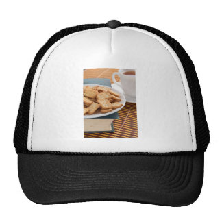 White plate with cookies on the old book trucker hat