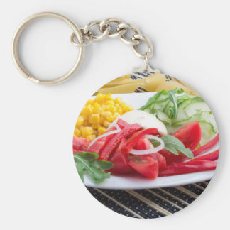 White plate with slices of fresh tomatoes basic round button keychain
