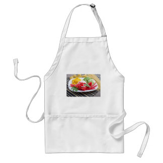 White plate with slices of fresh tomatoes standard apron