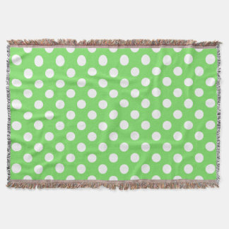 White polka dots on apple green throw