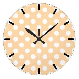White polka dots on beige clock