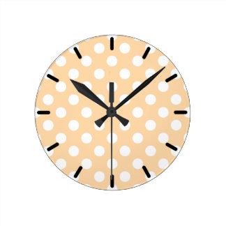 White polka dots on beige wall clocks