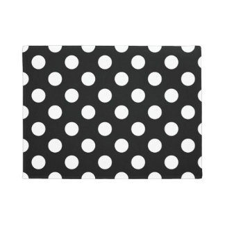 White polka dots on black doormat