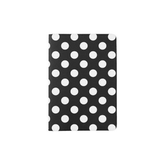 White polka dots on black passport holder