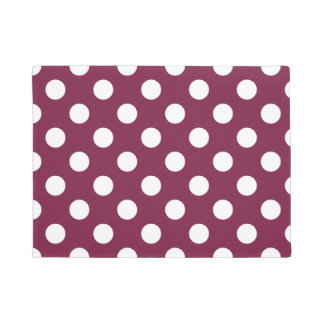 White polka dots on burgundy doormat
