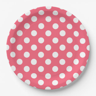 White polka dots on coral paper plate