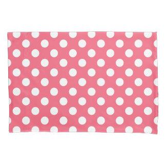 White polka dots on coral pillowcase