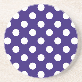 White polka dots on dark blue beverage coasters