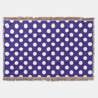 White polka dots on dark blue throw