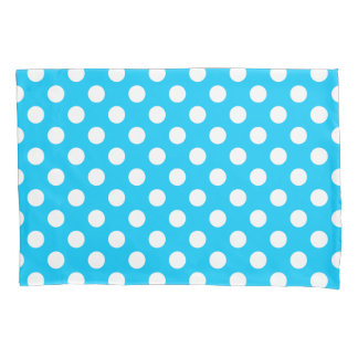 White polka dots on electric blue pillowcase