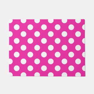 White polka dots on fuchsia doormat