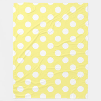 White polka dots on lemon yellow fleece blanket